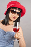 Asian Woman Wearing Sunglasses and Red Hat Royalty Free Stock Image