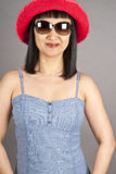 Asian Woman Wearing Sunglasses and Red Hat Stock Photos