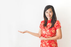 Asian woman wearing traditional chinese dress presenting. Portrait of asian woman wearing traditional chinese dress presenting to copy space Stock Photos