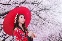Asian woman wearing traditional japanese kimono with red umbrella. Stock Images