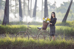 Asian woman wearing traditional thai culture,in field,vintage style. Asian woman wearing traditional thai culture,sitting in rice field stock photo