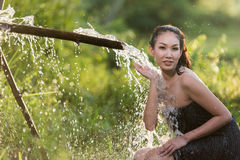 Asian woman wearing traditional thai culture take a baht on duri Stock Photography