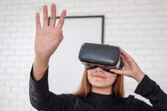 Asian woman wearing VR camera while enjoy playing games stock photo