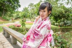 Asian woman wearing a yukata in Japanese style garden Royalty Free Stock Photo