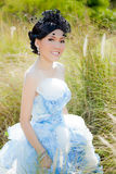 Asian woman in wedding suit Stock Photo