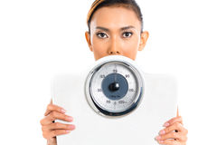 Asian woman with weight scale. Loosing weight stock photo