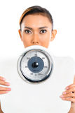 Asian woman with weight scale Royalty Free Stock Photography