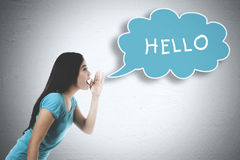 Asian woman whispering word of hello Stock Images