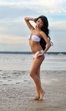 Asian woman in white bikini Stock Photography