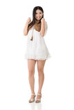 Asian woman with white short dress Royalty Free Stock Image