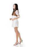 Asian woman with white short dress Stock Images