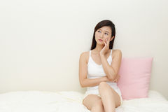 Asian woman who is worried Royalty Free Stock Images