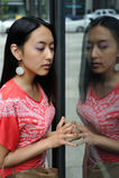 Asian woman window shopping Royalty Free Stock Image