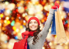 Asian woman in winter clothes with shopping bags Stock Images