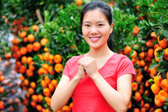 Asian woman wishing a happy chinese new year Royalty Free Stock Images