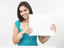 Asian Woman With A Blank Placard Royalty Free Stock Photo