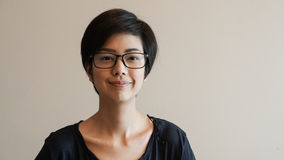 Free Asian Woman  With Short Hair And Glasses On Color Background Royalty Free Stock Photos - 98278758