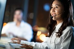 Free Asian Woman Work As Customer Support Service Or Call Center Phone Operator, Using Computer, Microphone Headset, Late Night Shift Royalty Free Stock Image - 169624876