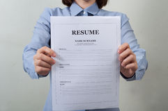 Asian woman in work wear displaying resume information. business Royalty Free Stock Photo