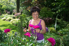 Asian Woman Working in Her Garden Royalty Free Stock Photos