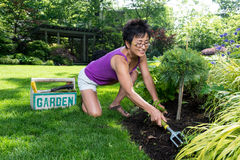 Asian Woman Working in Her Garden Stock Images