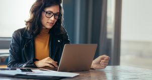 Asian woman working laptop at office. Asian woman working laptop. Business woman busy working on laptop computer at office royalty free stock image