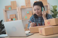Asian woman working on laptop at home office. Close up portrait Royalty Free Stock Image