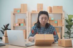 Asian woman working on laptop at home office. Close up portrait Royalty Free Stock Images