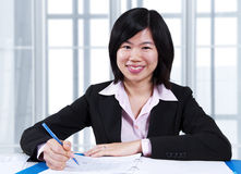 Asian woman working in office Stock Image