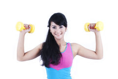 Asian woman working out with dumbell Stock Images