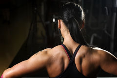 Asian woman working out in gym. From behind Stock Photo