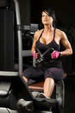 Asian Woman Working Out On Rower Royalty Free Stock Photo
