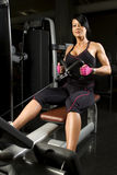 Asian woman working out on rower Stock Photography