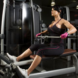 Asian woman working out on rower Stock Photos