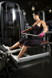Asian woman working out on rower Royalty Free Stock Photography