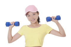 Asian woman working out using dumbbell weights isolated on white Royalty Free Stock Photo