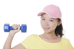 Asian woman working out using dumbbell weights isolated on white Stock Images