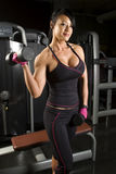 Asian woman working out with weights Royalty Free Stock Image