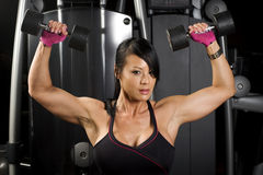 Asian woman working out with weights Stock Photo