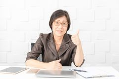 Asian woman working stock images