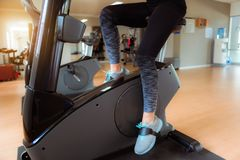 Asian woman workout on cycling in fitness gym., Sports and healt. Hy concept Royalty Free Stock Image