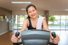 Asian woman workout on cycling in fitness gym., Sports and healt. Hy concept Stock Images