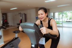 Asian woman workout on cycling in fitness gym, Sports and health. Asian woman workout on cycling in fitness gym., Sports and healthy concept Royalty Free Stock Images