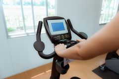 Asian woman workout on cycling in fitness gym, Sports and health. Asian woman workout on cycling in fitness gym., Sports and healthy concept Stock Photo