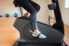 Asian woman workout on cycling in fitness gym, Sports and health. Asian woman workout on cycling in fitness gym., Sports and healthy concept Stock Image