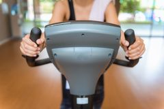 Asian woman workout on cycling in fitness gym, Sports and health. Asian woman workout on cycling in fitness gym., Sports and healthy concept Royalty Free Stock Image