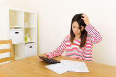 Asian woman worries about the budget. Asian woman worries about the expenditure at home Stock Photography