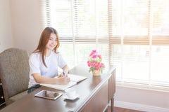 Asian woman writing book Stock Photo