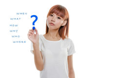 Asian woman Writing wh- questions stock photos