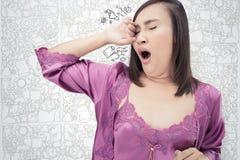 Asian woman yawning. royalty free stock photos